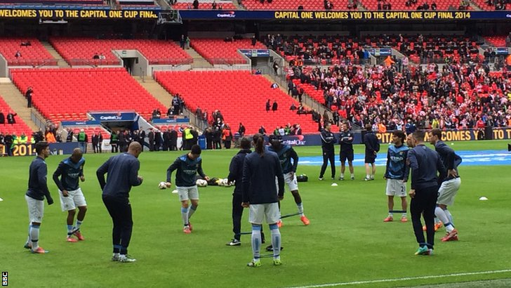 Manchester City players warm up for their match against Sunderland