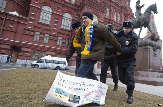 Police arrest a pro-Ukraine protester near the Kremlin in Moscow, 2 March