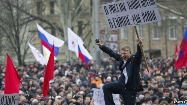 Pro-Russian protesters with Russian flags take part in a rally in central Donetsk
