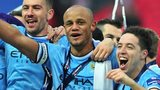 Manchester City's Vincent Kompany (centre), Samir Nasri (right) and Aleksandar Kolarov celebrate