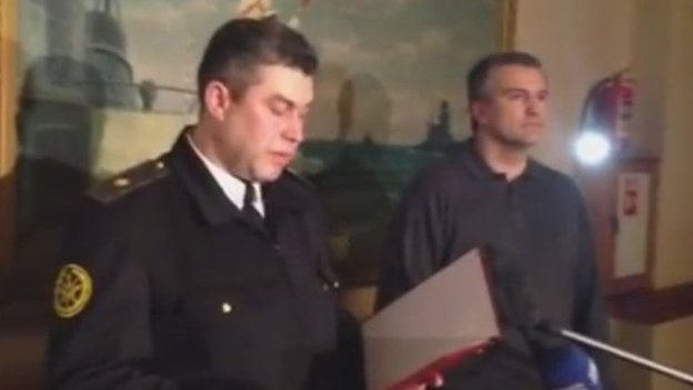 Rear Admiral Denis Berezovsky reads out his oath in Sevastopol alongside Crimea's pro-Russian leader, Sergiy Aksyonov, 2 March