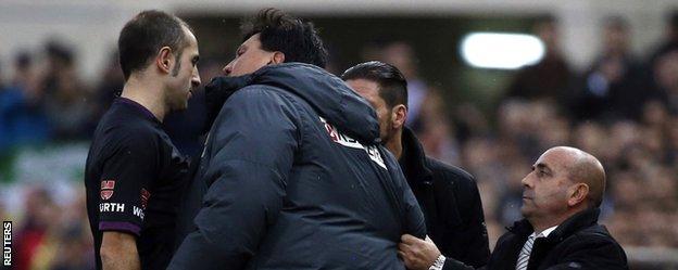 "Atletico Madrid""s second coach Burgos argues with referee Delgado Ferreiro"