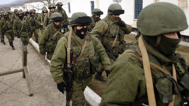 Unidentified troops surround a Ukrainian military base in Crimea. 2 March 2014