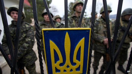 Ukrainian soldiers guard a gate to their military base in Perevalnoye, Ukraine, on March 2 2014