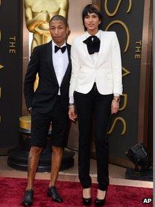 Pharrell Williams, left, and Helen Lasichanh