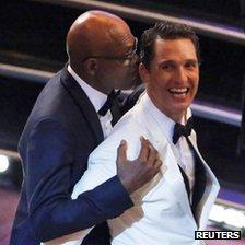Best actor nominee Matthew McConaughey jokes with Samuel L. Jackson