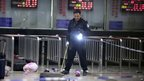 A Chinese police investigator inspects the scene of an attack at the railway station in Kunming, southwest China's Yunnan province on 2 March 2014