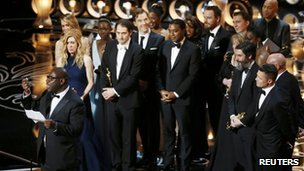 Director and producer Steve McQueen accepts the Oscar for best picture at the 86th Academy Awards