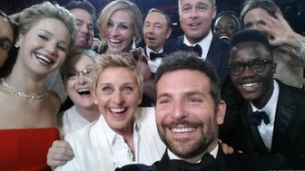 Ellen DeGeneres takes a picture with stars of the Oscars