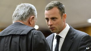 Defence lawyer Barry Roux speaking with Oscar Pistorius