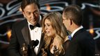 Peter Del Vecho, Jennifer Lee and Chris Buck accept the Oscar for best animated feature film for Frozen at the 86th Academy Awards in Hollywood