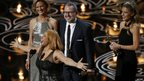 Darlene Love sings as Morgan Neville and Caitrin Rogers look on as they accept the Oscar for best documentary feature for 20 Feet from Stardom