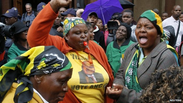 Members of the African National Congress Women's League sing in front of the courthouse ahead of the trial of Olympic and Paralympic track star Oscar Pistorius at the high court in Pretoria, 3 March 2014