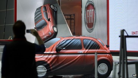 Person takes photo at Fiat booth