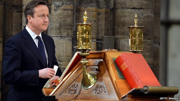 David Cameron stands at the lectern for his Bible reading during a National Service of Thanksgiving to celebrate the life of Nelson Mandela