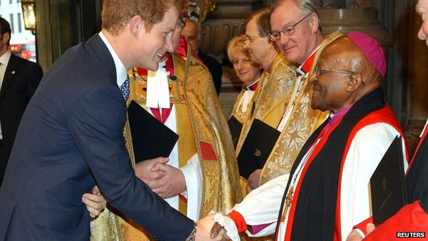 Prince Harry shakes hands with Archbishop Desmond Tutu
