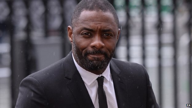 Actor Idris Elba arrives for the service