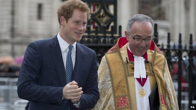 Prince Harry walks with Dean of Westminster Abbey John Hall