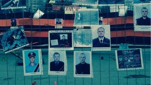 Image of photos pinned to railing in Kharkiv, Ukraine