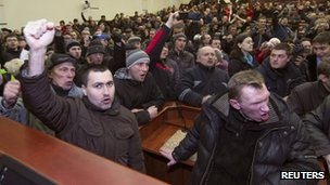 Pro-Russian demonstrators hold a meeting after entering the regional government building in Donetsk, on 3 March 2014.