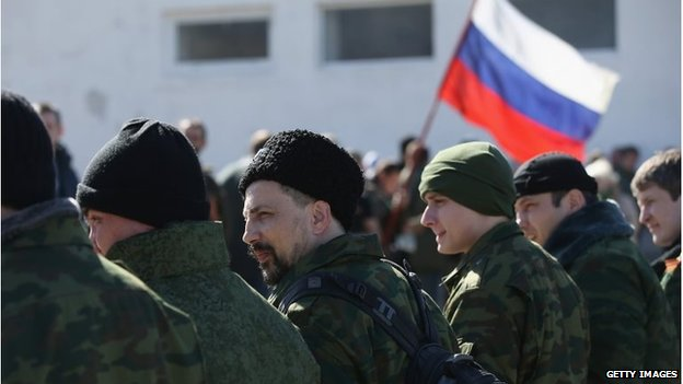 Militiamen outside a Ukrainian base in Perevalne, Crimea, March 3