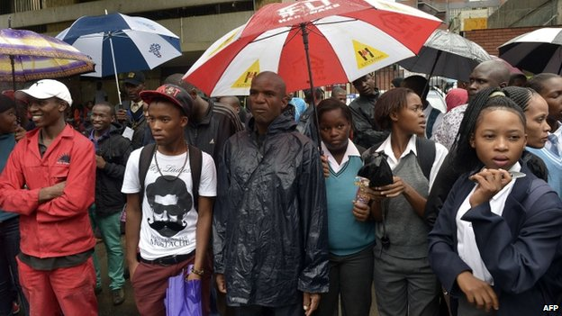 School children and members of the public try to see Oscar Pistorius as he leaves the Pretoria high court on 3 March 2014