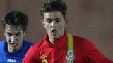 Emyr Huws in action for Wales Under- 21s