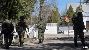 Armed men in military fatigues block access to Ukrainian military barracks in Bakhchisaray, Crimea. Photo: 3 March 2014