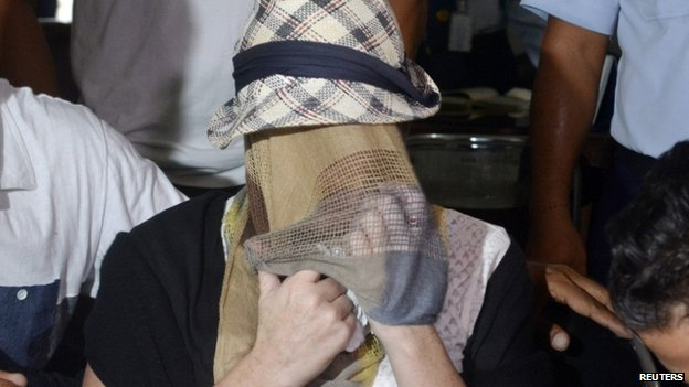 Convicted Australian drug trafficker Schapelle Corby is seated to be processed at the Denpasar Parole Board Office following her release from Kerobokan Prison in Denpasar, Bali, 10 February 2014