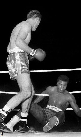 Henry Cooper floors Cassius Clay