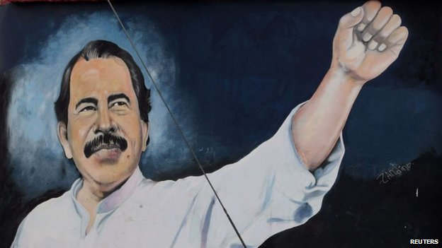Mural depicting Nicaragua's President Daniel Ortega on the wall of a state building in Managua on 10 February, 2014
