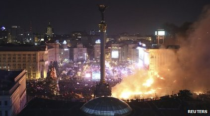 Aerial shot of the protest in Kiev with smoke billowing into the sky