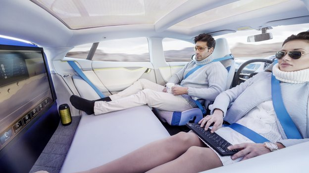 man and woman in interior of a driverless car