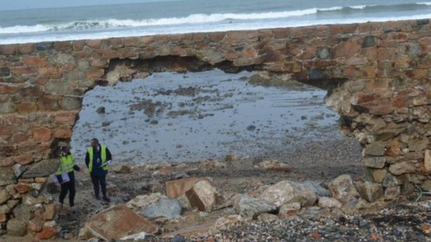 The Vazon sea wall being examined by States Works engineers