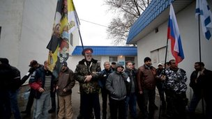 Pro-Russian supporters stand in line outside the headquarters of the Ukrainian Navy in Sevastopol on 4 March 2014.