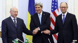 US Secretary of State John Kerry (C), Oleksandr Turchynov, Parliament Speaker and Ukraine's interim President (L) and Ukrainian Prime Minister Arseniy Yatsenyuk shake hands during their talks in Kiev on March 4, 2014.