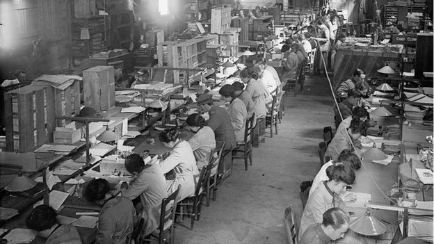 Women's Army Auxiliary Corps clerks at work alongside male colleagues at an advanced motor transport depot at Abbeville, France, on 15 September 1917.
