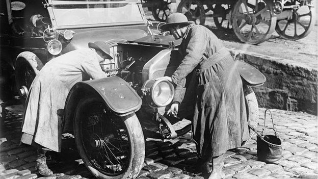 Women's Army Auxiliary Corps mechanics at work on a car engine at Abbeville, France, on 15 September 1917.