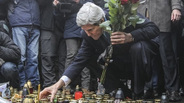 John Kerry lights a candle