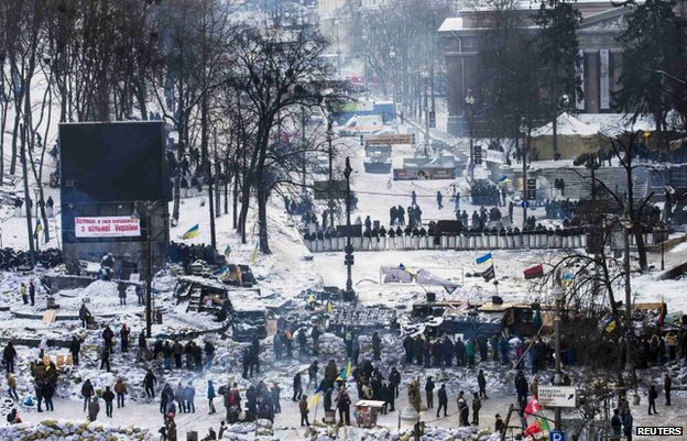 Riot police and protesters face off in Independence Square