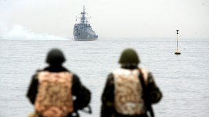 Ukrainian marines watch a Russian ship off the Sevastopol coast