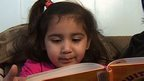 Ayleen Alfaro, age three, reading