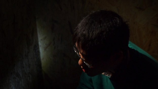 A young actor giving an interview, speaking the words of a Vietnamese boy who was trafficked
