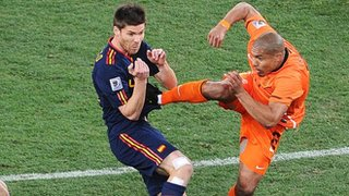 Nigel de Jong puts in a high tackle on Xabi Alonso