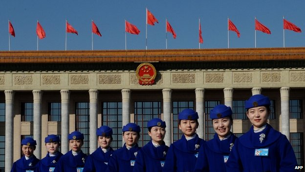 Chinese hostesses pose for photographers during the National People's Congress at the Great Hall of the People in Beijing, 5 March 2014