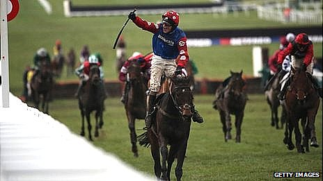 Harry Derham celebrates on Salubrious after winning the Martin Pipe Conditional Jockeys' Handicap Hurdle on Cheltenham Gold Cup day 2013