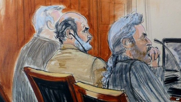 In this courtroom sketch, Sulaiman Abu Ghaith, centre, is flanked by his legal team 3 March 2014