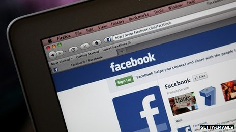 Facebook front page on computer screen, file photo
