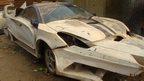 A car being remodelled to look like a crocodile at Godfrey Namunye's vehicle workshop in Kampala, Uganda