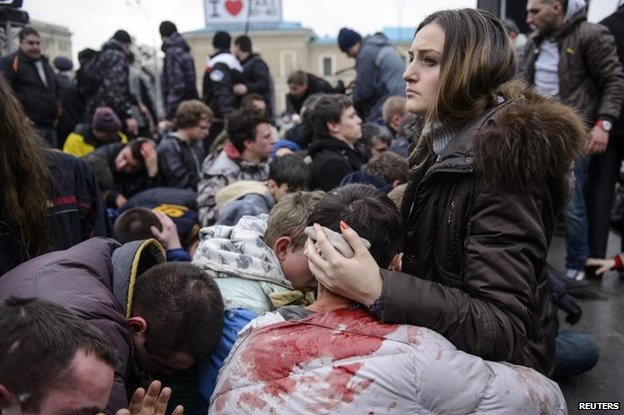 Injured pro-Kiev demonstrators in Kharkiv after clashes with pro-Russian demonstrators (1 March 2014)